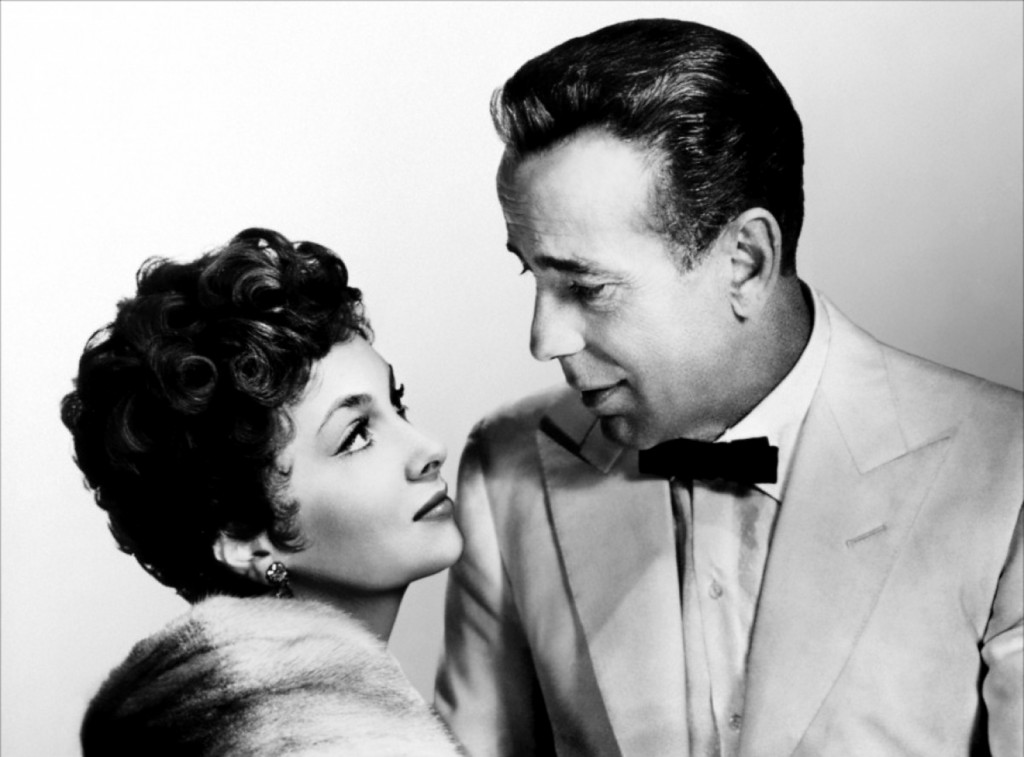 "Gina com Humphrey Bogart em 'Beat the devil""."